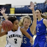 Reagan Dykes (15) defends Veritas ball handler Deja Bradford (2) as PCS teammate Trista Magee lends verbal support on Thursday, February 26, 2015, at the MAIS Overall Basketball Tournement in the A.E. Wood Coliseum on the Mississippi College campus in Clinton.
