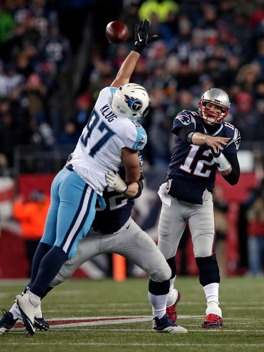 New England Patriots quarterback Tom Brady (12) passes over Tennessee Titans defensive end Karl Klug (97) during the first half of an NFL divisional playoff football game, Saturday, Jan. 13, 2018, in Foxborough, Mass. (AP Photo/Charles Krupa)