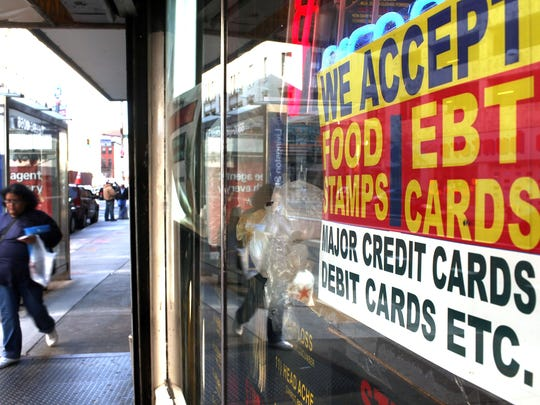 A sign advertises that a store accepts EBT cards.