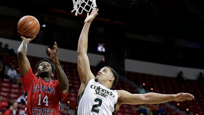Fresno State's Julien Lewis shoots over Colorado State's Daniel Bejarano during the second half of an NCAA college basketball game in the quarterfinal round of the Mountain West Conference tournament Thursday, March 12, 2015, in Las Vegas. Colorado State defeated Fresno State 71-59. (AP Photo/Isaac Brekken)