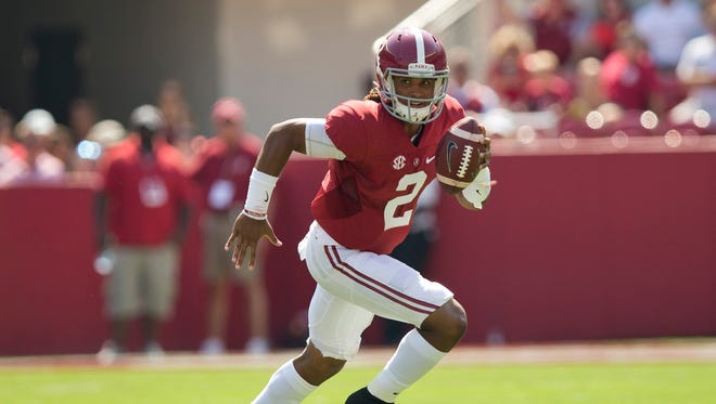 Alabama quarterback Jalen Hurts scrambles against Kent State.