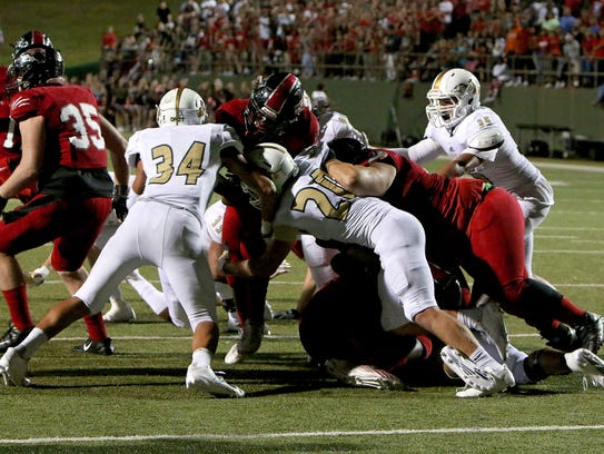 The Rider defense stops a Wichita Falls High running