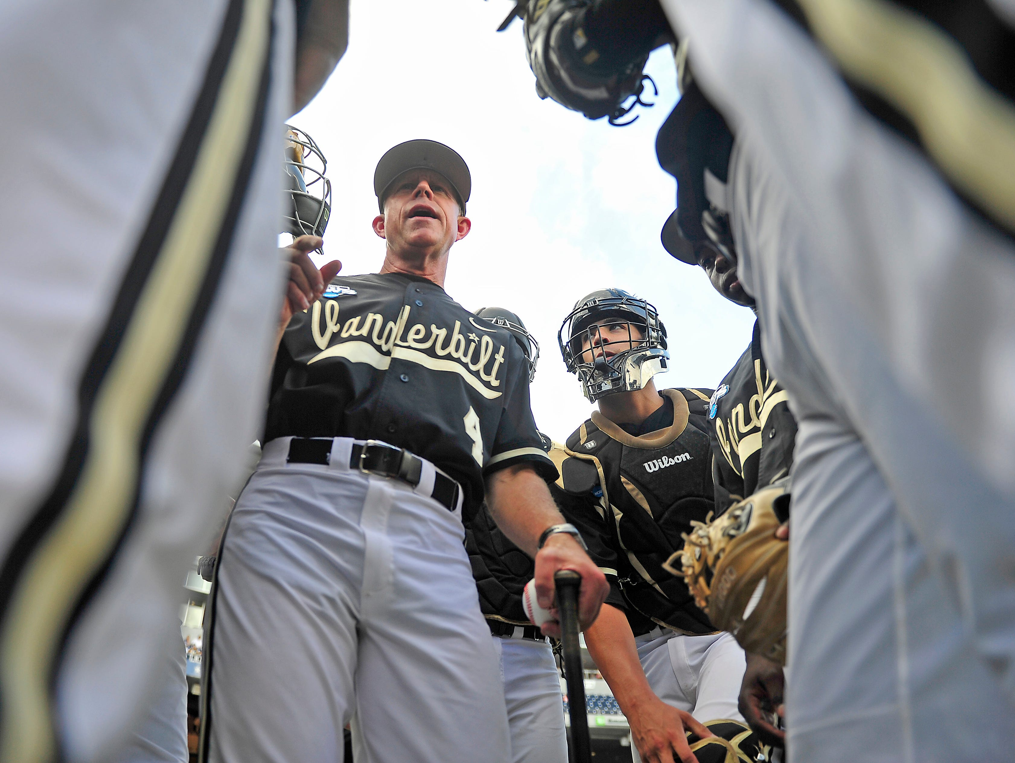 Vanderbilt Head Coach Tim Corbin talks with his players prior to the game 3 against Virginia at the College World Series at TD Ameritrade Park in Omaha, Neb., Wednesday, June 25, 2014.
