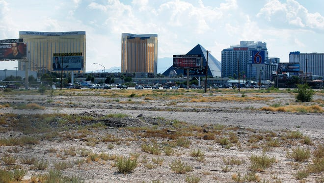 In this July 1, 2016, file photo, a vacant lot that is the site of a proposed football stadium sits near McCarran International Airport in Las Vegas. Nevada lawmakers convene Monday, Oct. 10, 2016, to consider raising taxes in the Las Vegas area to help fund a $1.9 billion football stadium, a $1.4 billion convention center expansion and more police officers to protect the additional tourists.