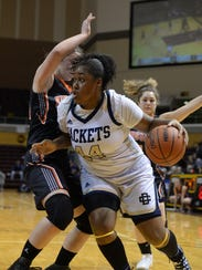 Detroit Country Day's Maxin Moore drives to the basket