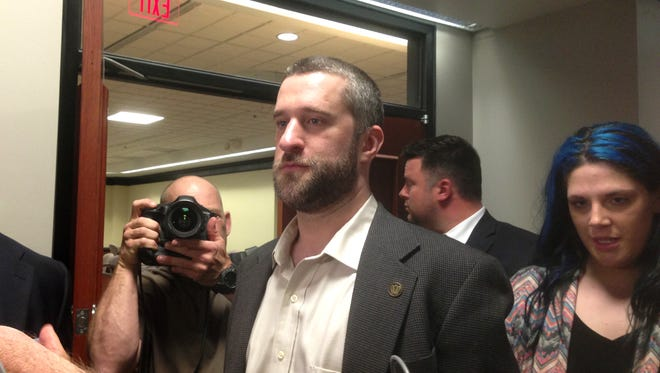 In this May 29, 2015, file photo, television actor Dustin Diamond, center, leaves court in Port Washington, Wisc., after being convicted of two misdemeanors stemming from a barroom fight on Christmas Day 2014.