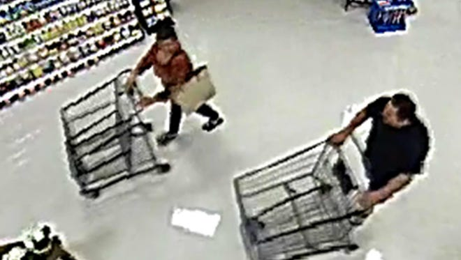 A woman seen on surveillance in Brookshire's is suspected of stealing a cell phone left in a shopping cart.