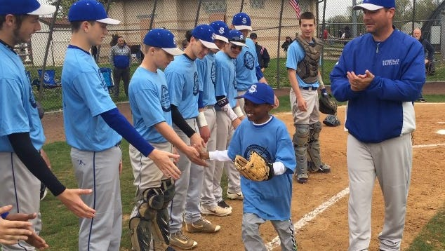 Tyler Davis of Sayreville threw ceremonial first pitch prior to Bombers' Autism Awareness Baseball Challenge game against Hudson Catholic on Saturday