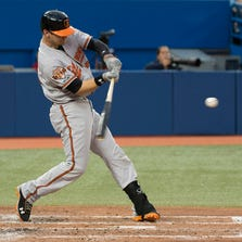 Aug 7, 2014; Toronto, Ontario, CAN; Baltimore Orioles catcher Caleb Joseph (36) hits a two run home run during the fourth inning in a game against the Toronto Blue Jays at Rogers Centre. Mandatory Credit: Nick Turchiaro-USA TODAY Sports