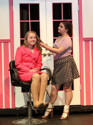 """Maija Veinbergs as Elle Woods and Julia Janda as Paulette Bonafonte prepare for the Pinckney High School Act 2 Theatre Company's performance of """"Legally Blonde, the Musical."""" The show runs April 21, 22, 28 and 29 at 7:30 p.m. at Pinckney Community High School.Pinckney High School Act 2 Theatre Company presents Legally Blonde, the Musical.Showtimes are April 21, 22, 28, & 29 at 7:30 p.m. & April 30 at 2:00 p.m.Tickets available on line at pchsact2.weebly.com $8.00Tickets are also available at the door. $10.00April 28th is a performance to benefit LACASA, all tickets will be $12.00Performances are held at Pinckney Community High School10255 Dexter-Pinckney Road, Pinckney, MI 48169Legally Blonde is a musical with music and lyrics by Laurence O'Keefe and Nell Benjamin and book by Heather Hach. The story is based on the novel Legally Blonde by Amanda Brown and the 2001 film of the same name. It tells the story of Elle Woods, a sorority girl who enrolls at Harvard Law School to win back her ex-boyfriend Warner. She discovers how her knowledge of the law can help others, and successfully defends exercise queen Brooke Wyndham in a murder trial. Throughout the show, no one has faith in Elle Woods, but she manages to surprise them when she defies expectations while staying true to herself."""