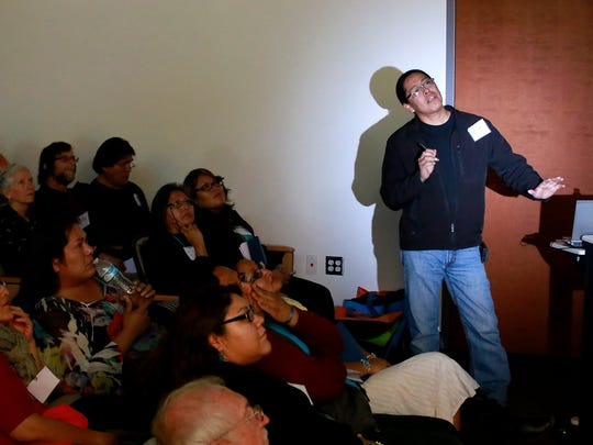 Kelly Francis of the Navajo Nation Heritage and Historical Preservation Department speaks during the Navajo Nation Archaeology Meeting on Friday at Diné College's south campus in Shiprock.