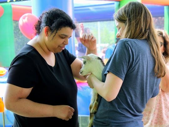 A petting zoo is among the attractions at Wednesday's Crusader Carnival, organized by seniors at Notre Dame High School.