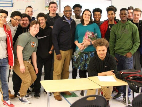 St. Georges Teacher of the year Frances Manciniwith junior spanish classes, from left, back row, Chris Dowd, Jake Huber, Michael Jourdan, Nasir Wright, Joey Bailey, Jake Hernandez;middle row, KuShaun Alexander, Ryan Carlino, Taras lee, Robert Shorts, Zachary Warren, Ronnie Cole; and front, Lio Silva, Cody Snavely, Shaun Randolphand Oliver Millwood.