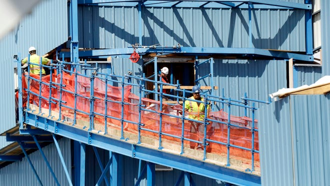 Workers navigate through the main span towers during construction of the new Tappan Zee Bridge April 1, 2016.
