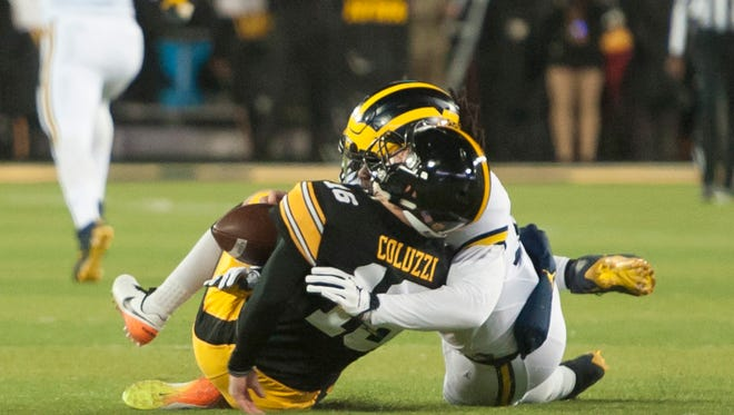 Michigan linebacker Devin Bush received a targeting penalty on this play with Iowa quarterback C.J. Beathard in the first quarter.