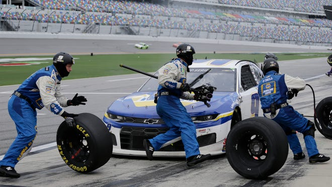 Chase Elliott makes a pit stop during a NASCAR Cup Series auto race at Daytona International Speedway, Sunday, Aug. 16, 2020, in Daytona Beach, Fla. Elliott went on to win the race.