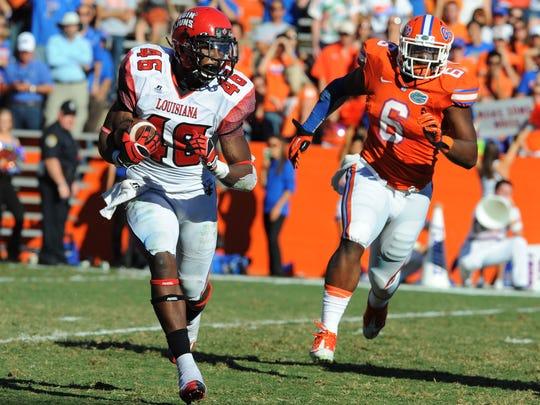 Louisiana-Lafayette running back Alonzo Harris rushes