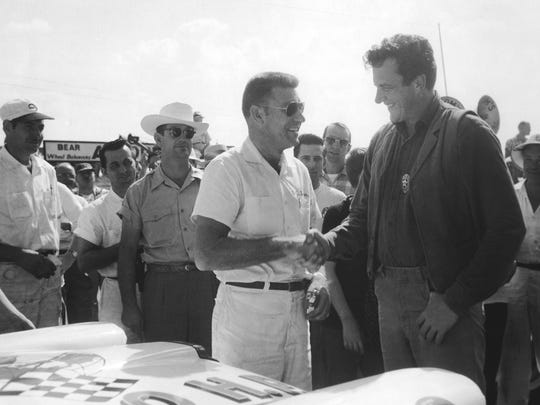 NASCAR driver Curtis Turner, left, shakes hands with