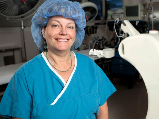Breast surgeon Christa Corn stands next to the Xoft
