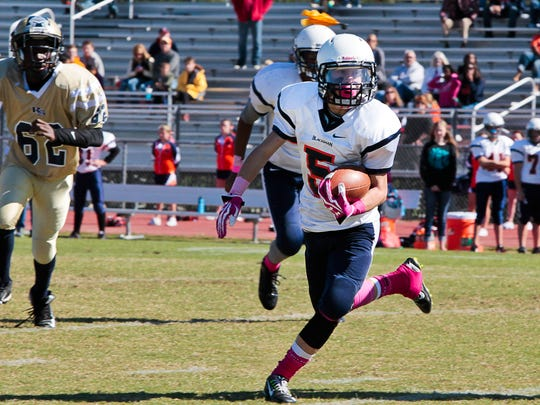 Blackman's Luke Hayes carries the ball in the Flames' 14-0 win over Rock Springs in the Rutherford County Middle School football Championship on Saturday at Oakland.