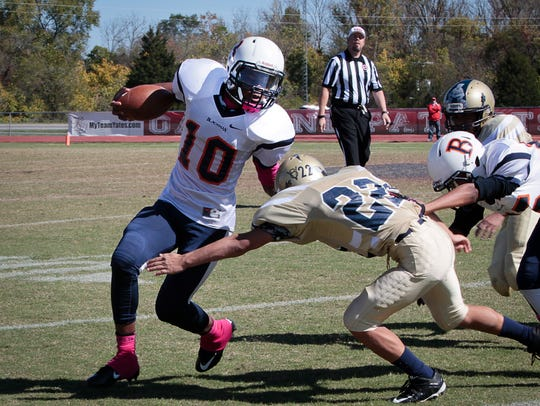 Blackman's Quinten Hunter carries the ball in the Flames'