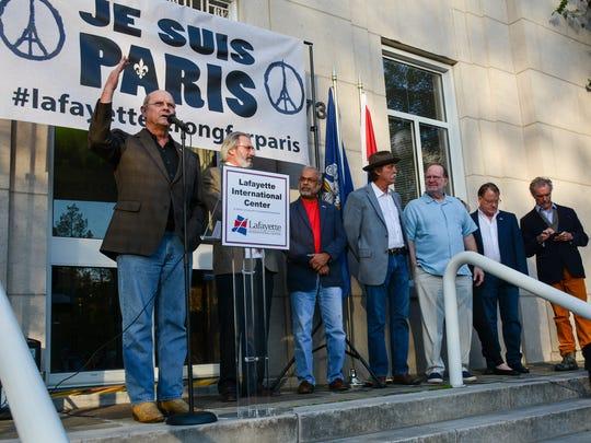 Joey Durel speaks to attendees at Solidarité Paris in Lafayette.