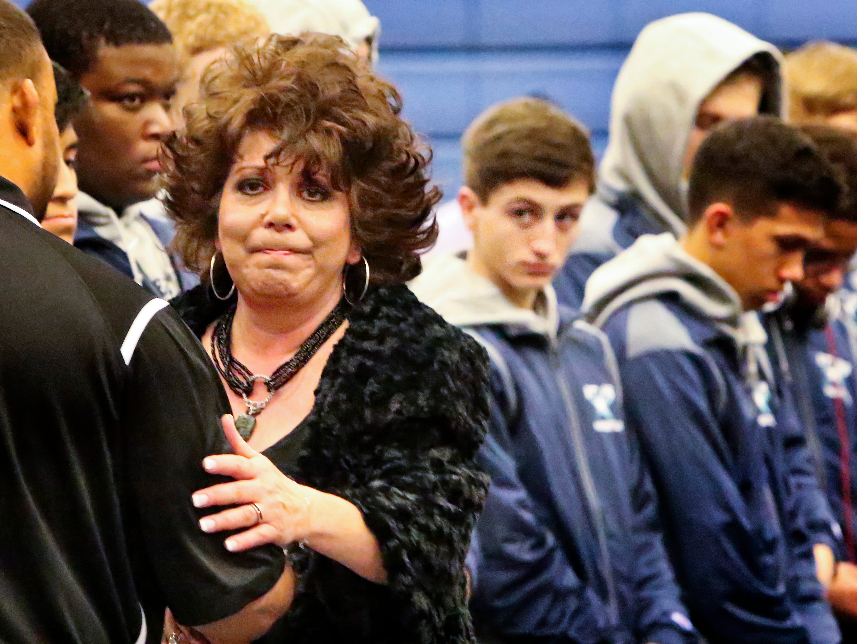 Melanie Loupe was honored prior to Siegel's first home wrestling match Wednesday. Loupe's son Mason, a football player and wrestler, died in September.