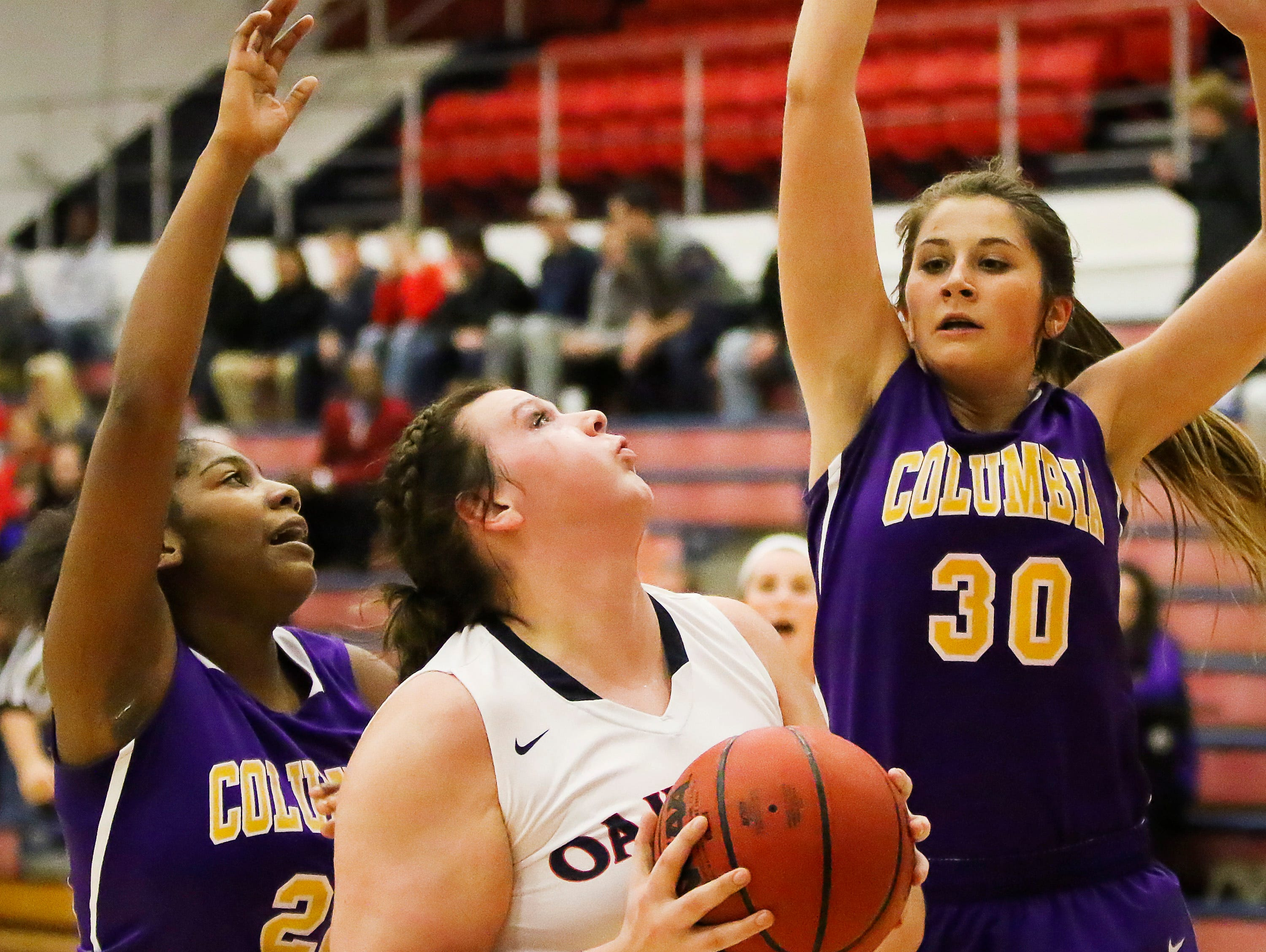 Oakland's Shelby Gibson prepares to go up for a shot over Columbia's Macy Gilliam during the Lady Patriots 79-11 win over the Lady Lions.