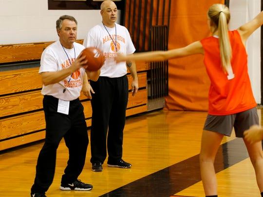 Marathon assistant coach Mick Lowie inbounds the ball