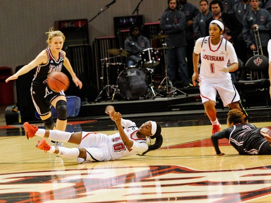 Kia Wilridge making a heads up pass from her back as the Cajuns take on Troy in an ESPN televised game in the Cajundome. Jan 23, 2016.