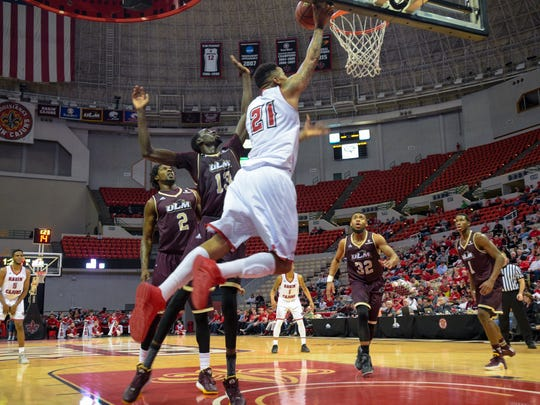 Shawn Long taking the ball to the basket as UL basketball host rare Tuesday SBC doubleheader taking on ULM in the Cajundome. Feb. 2, 2016.