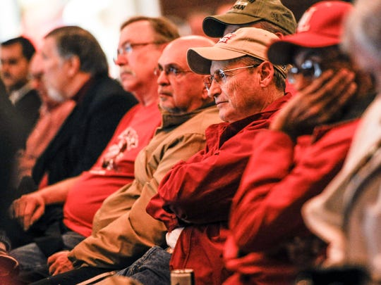 Ragin' Cajun fans listen intently on UL's signing bash Wednesday night.
