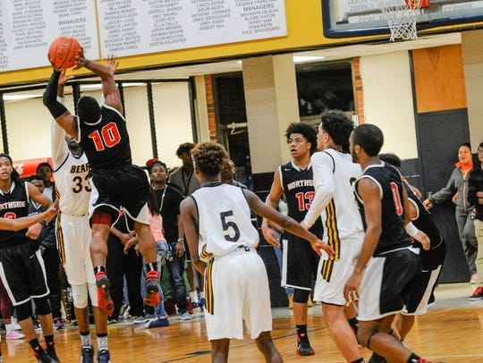 Christian Clinton goes up for the rebound as Basketball