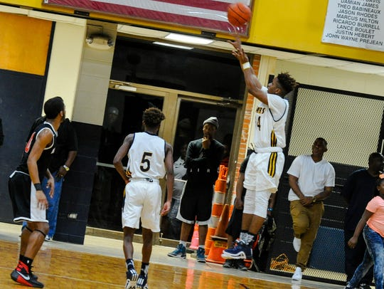 Bryson Fontenot shoots for three as Basketball fans