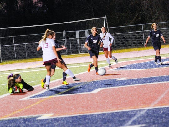 Emily Lejeune gets past the goal keeper and easily