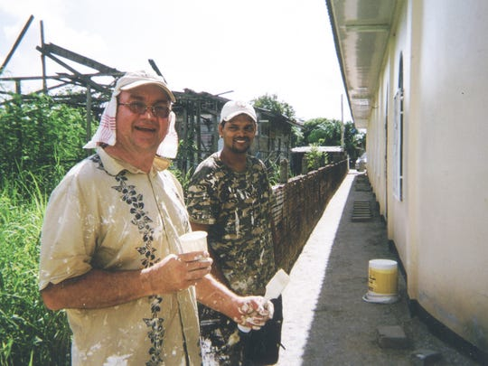 Jerry Newmann takes a break from spackling during a trip to Suriname in 2009.