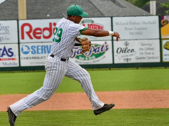 Miguel Reyes throws the runner out at at first as Acadiana