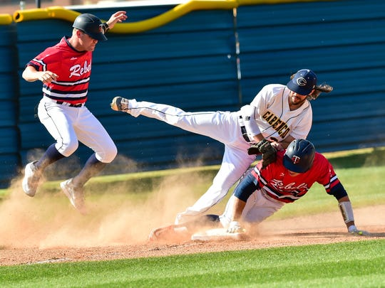 Jacob Richard slides hard into third base clearing out Nick Comeaux and Coach Mike Thibadeaux is quick to react  as Carencro baseball host the Teurlings Rebels. April 5, 2016.