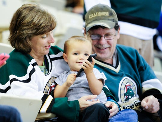 Wendie and Craig Hernandez with Brayden Roy enjoying the game as The IceGators take on the IceBears at the Cajundome. April 8, 2016.