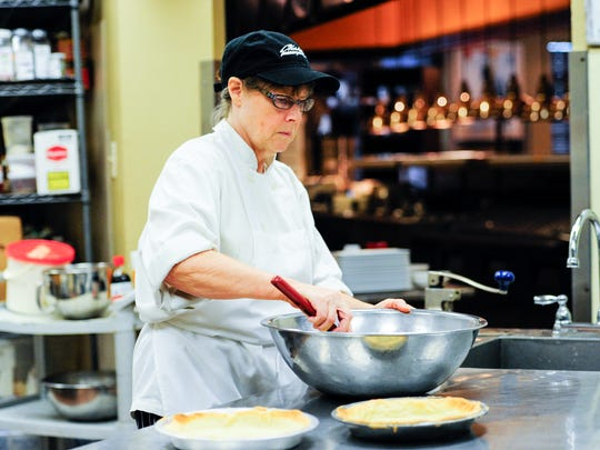 Sue Barras prepares buttermilk pie at Charley G's. She recently resumed her role as the restaurant's pastry chef after a few years away.