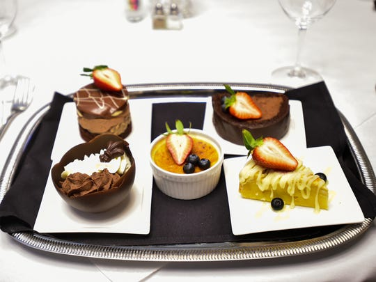 Sue Barras' dessert tray at Charley G's include options such as these. Pictured, from front, left to right, are the white and dark chocolate mousse cup, vanilla bean creme brulee, white chocolate bread pudding, chocolate praline tower and chocolate bomb.