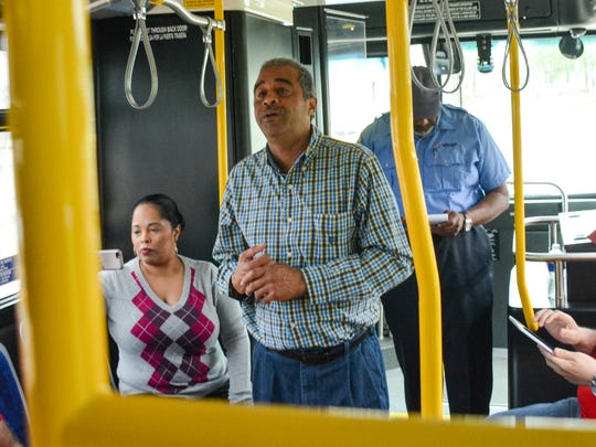 Bus tour hosted by Councilman Pat Lewis to identify