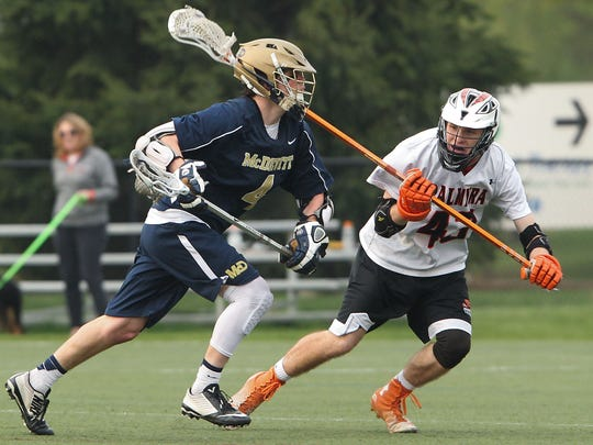 Palmyra senior Sean Taylor defends against Bishop McDevitt's Griffin Hanes during the Cougars' 15-2 win at In the Net on Thursday.