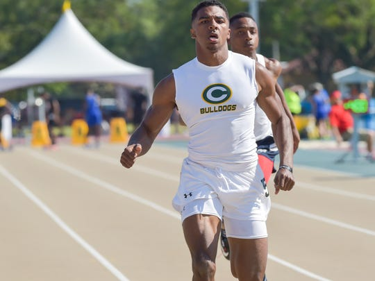 Raymond Calais in lane 5 for the boys 100 meter dash at the LHSAA Track and Field State Meet at LSU Bernie Moore Stadium.