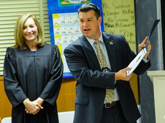 Magistrate Judge Carol Whitehearst and Deputy US Marshal Michael Dicharry.