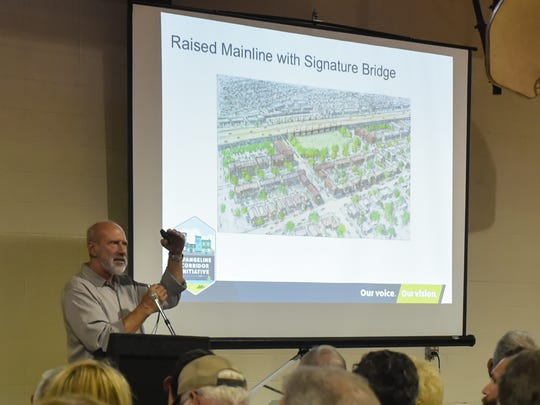 Steve Oubre with Architects Southwest unveils and explains high-quality plans and renderings of the corridor based on a week of feedback from the Public Charrette Week.