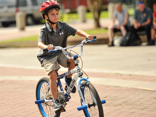Bryce David riding bike at the first Bicycle Safety