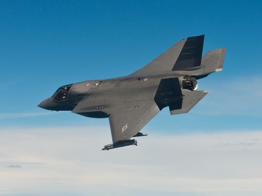 A test pilot assigned to the Salty Dogs of Air Test and Evaluation Squadron (VX) 23 flies an F-35B Lightning II during an Asymmetric Flying Qualities test. Aircraft BF-03, a multi-role Short Takeoff and Vertical Landing (STOVL) aircraft, is based at the F-35 Lightning II Pax River Integrated Test Force (ITF) located aboard NAS Patuxent River, Md. (Lockheed Martin photo by Dane Wiedmann)