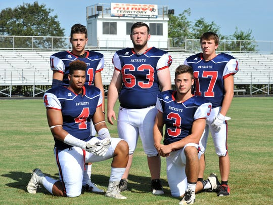 North Vermillion High School varsity defensive players pose for team photo.