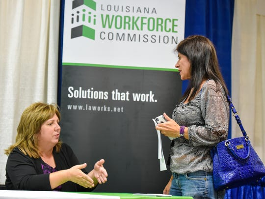 Missy Grimmett with Louisiana Workforce speaking with fair attendee Michelle Sandridge at the Cumulus Acadiana Career Expo.